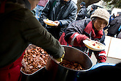 Approximately 700 homeless men attend a soup kitchen run by a Korean Christian church, in Ueno Park, Tokyo, Japan, Friday 27th March 2009. The men, most of whom are long term homeless, attend the soup kitchen 4 times a week, and have to listen to a church sermon prior to being given a hot lunch, food to take away, and if they wish they can have haircuts, and obtain clothes.