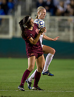 Dagny Brynjarsdottir (7) of Florida State fights for the ball with Taylor Antolino (17) of Virginia Tech during the Women's College Cup semifinals at WakeMed Soccer Park in Cary, NC. Florida State defeated Virginia Tech, 3-2.
