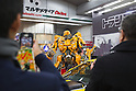 Dec 15, 2011, Tokyo, Japan - People take photos of the large scale figure of Bumblebee from the movie, &quot;Transformers Dark Side of the Moon&quot; is displayed at a electronics store in downtown Tokyo. The &quot;Transformers Dark Side of the Moon&quot; DVD will be released in Japan on December 16. (Photo by Christopher Jue/AFLO)