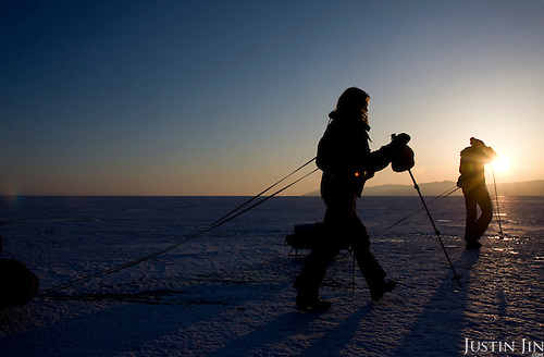 Heleen treks across frozen Lake Baikal in Siberia, Russia. .They are a group of five people: Justin Jin (Chinese-British), Heleen van Geest (Dutch), Nastya and Misha Martynov (Russian) and their Russian guide Arkady. .They pulled their sledges 80 km across the world's deepest lake, taking a break on Olkhon Island. They slept two nights on the ice in -15c. .Baikal, the world's largest lake by volume, contains one-fifth of the earth's fresh water and plunges to a depth of 1,637 metres..The lake is frozen from November to April, allowing people to cross by cars and lorries.