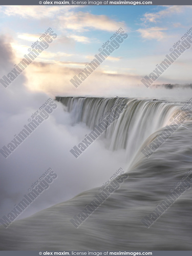 Brink of Niagara Falls Canadian Horseshoe beautiful sunrise scenery in soft pastel colors, wintertime scenic. Niagara Falls, Ontario, Canada.