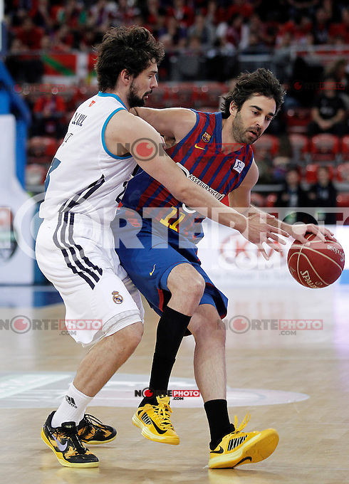 Real Madrid's Sergio Llull (l) and FC Barcelona Regal's Juan Carlos Navarro during Spanish Basketball King's Cup match.February 07,2013. (ALTERPHOTOS/Acero) /Nortephoto