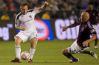 Midfielder of the LA Galaxy Chris Birchall sends a ball just before advancing Colorado Rapids forward Conor Casey. The Colorado Rapids defeated the LA Galaxy 3-1 at Home Depot Center stadium in Carson, California on Saturday October 16, 2010.