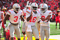 Buckeyes' QB J.T. Barrett celebrates a touchdown with his teammates. Ohio State trounced Maryland 52-24 during a game at the Capital One Field in Byrd Stadium, College Park, MD on Saturday, October 4, 2014.  Alan P. Santos/DC Sports Box