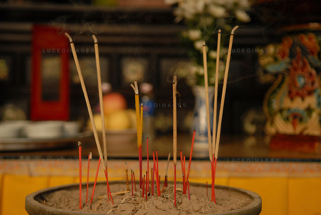 Essence burns after people prayed for loved ones at a pagoda in Ho Chi Minh City, Vietnam.