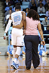 25 March 2014: North Carolina's Diamond DeShields (23) is helped off the court after suffering a first half head injury. The University of North Carolina Tar Heels played the Michigan State University Spartans in an NCAA Division I Women's Basketball Tournament First Round game at Cameron Indoor Stadium in Durham, North Carolina. UNC won the game 62-53.