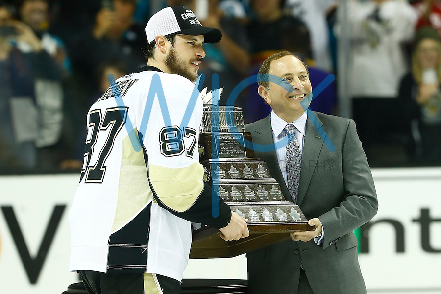 NHL commissioner Gary Bettman presents the Conn Smythe trophy to Sidney Crosby #87 of the Pittsburgh Penguins during game six of the Stanley Cup Final at SAP Center in San Jose, California on June 12, 2016. (Photo by Jared Wickerham / DKPS)