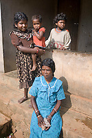 Wayanad, Kerala, India, April 2008. People of the Paniyas tribe welcom us with some hesitation.  Wayanad has the largest population of aborigine people in Kerala. The native adivasis mainly consist of various sects like Paniyas, Kurumas, Adiyars, Kurichyas, Ooralis, Kattunaikkans etc. The Wayanad district of Kerala offers wildlife viewing opportunities, an insight into tribal culture evocative of earlier centuries, trekking and other adventure activities. Photo by Frits Meyst/Adventure4ever.com