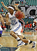 UNC guard Cetera DeGraffenreid drives the ball in the second half. This game was one of the two Semifinal games of the 2011 ACC Tournament in Greensboro on Saturday, March 5, 2011. UNC beat Miami 83-57. (Photo by Al Drago)