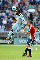 Sporting KC forward (17) C.J Sapong wins the header against Chivas USA defender Heath Pearce... Sporting KC and Chivas USA played to a 1-1 tie at LIVESTRONG Sporting Park, Kansas City, Kansas.
