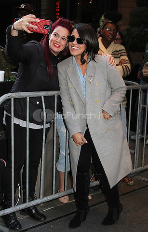 NEW YORK, NY - MAY 19:  Gina Rodriguez takes a selfie with a fan as she leaves her hotel in New York, New York in May 19, 2016. Photo Credit: Rainmaker Photo/MediaPunch