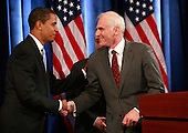 Chicago, IL - December 18, 2008 -- United States President-elect Barack Obama shakes hands with Daniel Tarullo after introducing him as his selection to the Federal Reserve Board of Governors during a press conference at the Drake Hotel December 18, 2008 in Chicago, Illinois. .Credit: Scott Olson - Pool via CNP