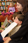 A youth enjoys a book reading during SFMOMA's Family Day at Linden Tree Books.