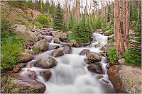 Cold waters flow down Glacier Creek in Rocky Mountain National Park in this image from Colorado's Rocky Mountains. It is a very short hike to this point and is usually very crowded. Still, there are some nice areas to take some shots of RMNP's amazing scenery.