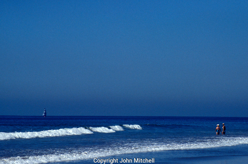Bathers and waves breaking on the beach, Mazatlan, Sinaloa, Mexico