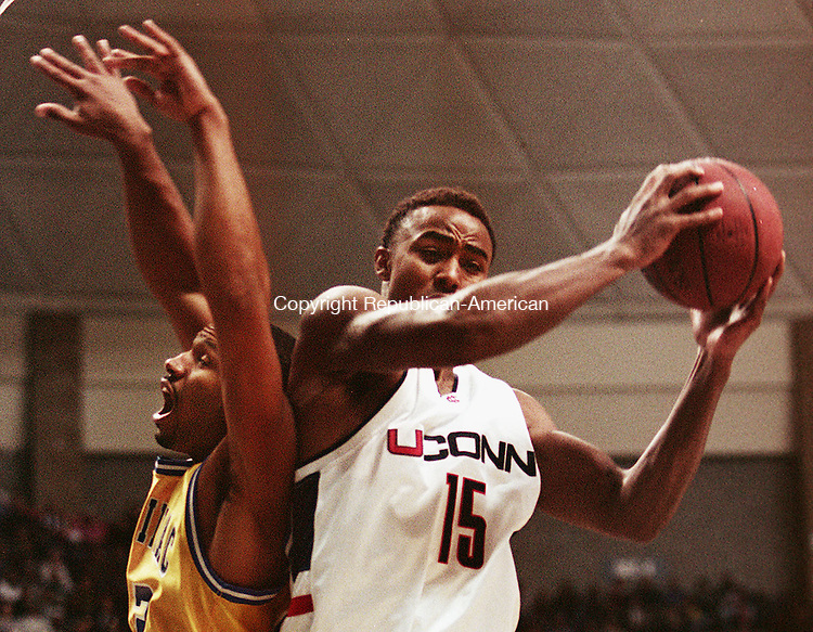 STORRS,CT. 11/15/98--1115SV05.tif--#15 Kevin Freeman of UConn goes up for the ball against #22 Ivoree Stanley of Quinnipiac in Storrs on Sunday. Steven Valenti Photo for Lewis story.