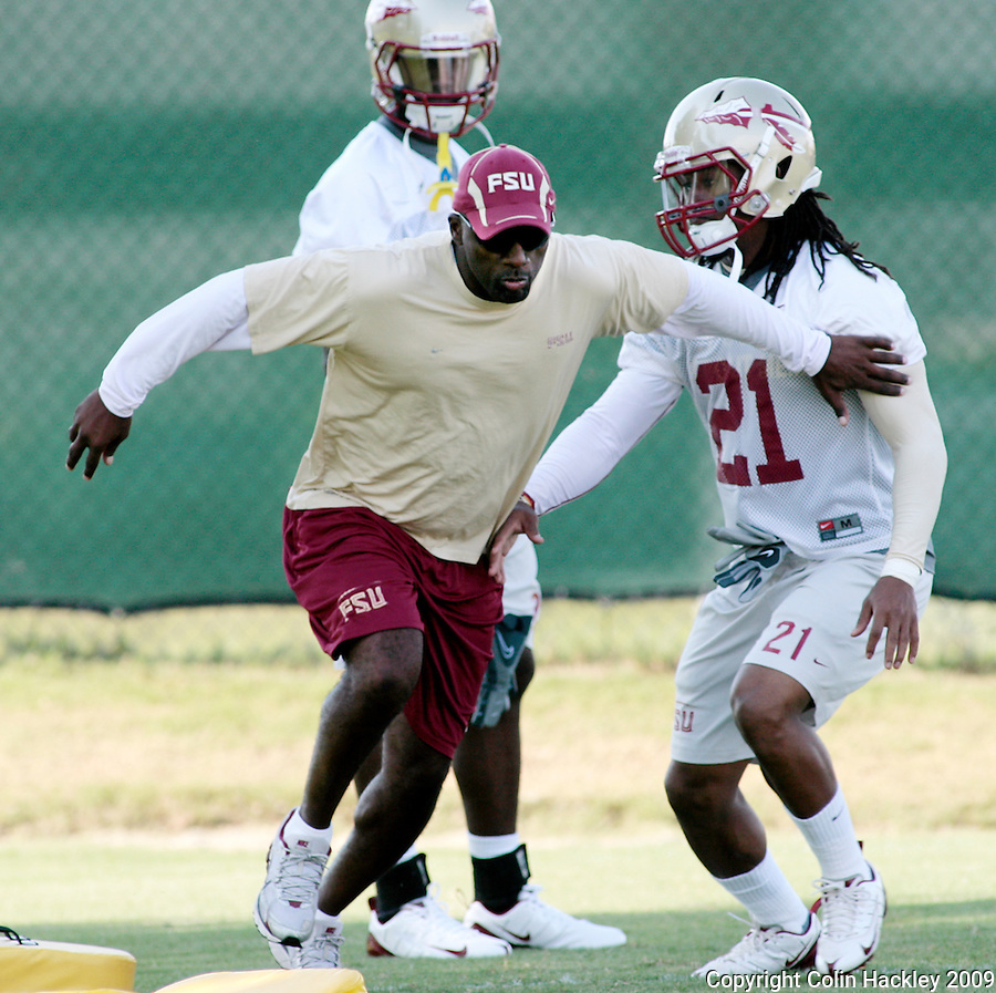 TALLAHASSEE, FL. 8/7/09-FSU-BUCKLEY0807 CH01-Graduate Assistant Terrell Buckley works with Florida State cornerbacks Patrick Robinson, right, and Xavier Rhodes  during practice Friday in Tallahassee...COLIN HACKLEY PHOTO