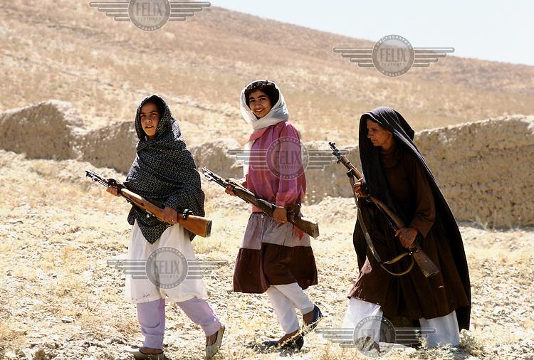 Three Afghan village militia women with guns...