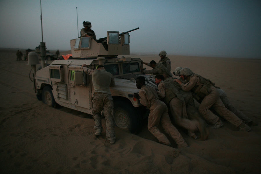 Marines from Weapons Co. 1st Battalion 6th Marines carry out a patrol in the Garmsir District of Afghanistan's Helmand Province.