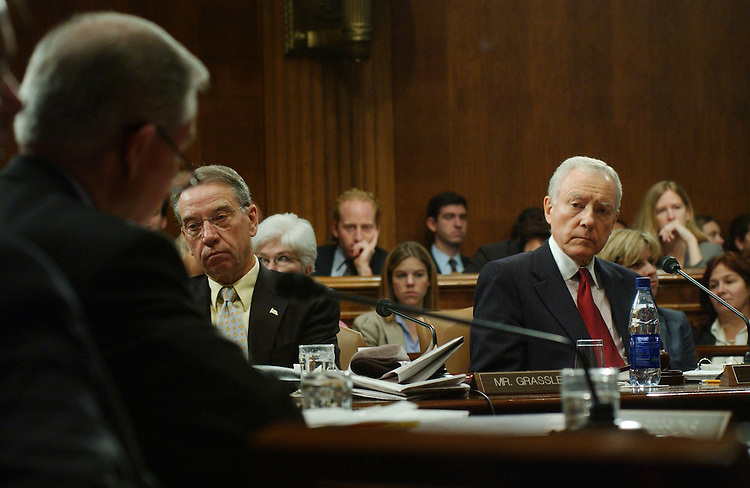 """10/16/03.JUDICIARY BILLS AND NOMINATIONS--During the Senate Judiciary Committee markup, Sen. Charles E. Grassley, R-Iowa, and Chairman Orrin G. Hatch, R-Utah, listen as Sen. Jeff Sessions, R-Ala., makes a statement opposing S1545, the """"Development, Relief, and Education for Alien Minors (DREAM) Act of 2003."""" The committee also considered several judicial nominations and other legislation..CONGRESSIONAL QUARTERLY PHOTO BY SCOTT J. FERRELL"""