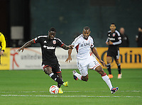 Washington D.C. - April 5, 2014: Eddie Johnson of D.C. United goes against Jose Goncalves from the New England Revolution.  D.C. United defeated 2-0 the New England Revolution during a Major League Soccer match for the 2014 season at RFK Stadium.