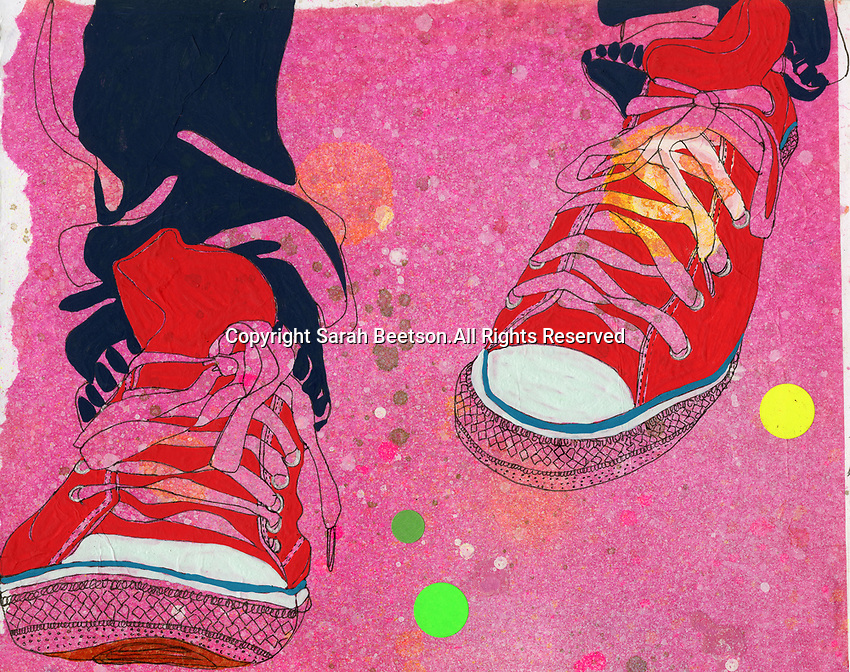 Feet wearing pair of red canvas shoes