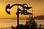 Seattle waterfront  with silhouetted sculpture with Elliott bay