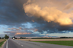 Dramatic Low Clouds Over Highway During Sunset, Estonia