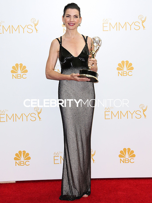 LOS ANGELES, CA, USA - AUGUST 25: Actress Julianna Margulies, winner of the Outstanding Lead Actress in a Drama Series Award for 'The Good Wife' poses in the press room at the 66th Annual Primetime Emmy Awards held at Nokia Theatre L.A. Live on August 25, 2014 in Los Angeles, California, United States. (Photo by Celebrity Monitor)
