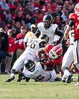 The Georgia Bulldogs beat the App State Mountaineers 45-6 in their homecoming game.  After a close first half, UGA scored 31 unanswered points in the second half.  Appalachian State Mountaineers defensive back Joel Ross (26) and Appalachian State Mountaineers linebacker Kennan Gilchrist (6) tackle Georgia Bulldogs running back Todd Gurley (3)
