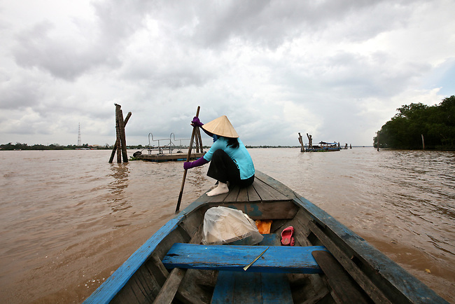 A woman paddles a boat in the Mekong Delta near My Tho, Vietnam. Oct. 3, 2011.