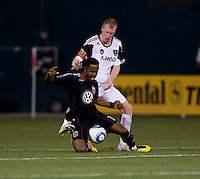 Luciano Emilio (11) of D.C. United is fouled from behind by Nat Borchers (6) of Real Salt Lake during a U.S. Open Cup tournament game at RFK Stadium in Washington, DC.  D.C. United defeated Real Salt Lake, 2-1, in overtime.