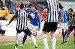 St Johnstone v Dunfermline....25.02.12   SPL.Fran Sandaza is closed down by Joe Cardle, Paddy Boyle and Gary Mason.Picture by Graeme Hart..Copyright Perthshire Picture Agency.Tel: 01738 623350  Mobile: 07990 594431