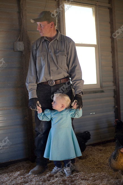 "Fundamentalist Mormon group F.L.D.S.,  Keith Dutson with his daughter, ""Yearning for Zion"" compound in Eldorado, Texas, USA, February 11, 2009"