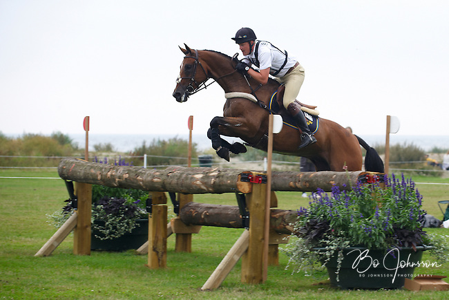Niklas Lindback (SWE) and Mr Pooh during the cross country. FEI Eventing CIC*** at Malmo City Horse Show 2010. <br /> The couple was placed 10th after Friday's dressage, was placed 1st after Saturday's cross country (this pic) and finished as 1st after Sunday's show jumping.<br /> The Swedish Championship - won by Niklas and Mr Pooh - was a competition-in-the-competition of the World Cup CIC***.<br /> This was good meeting for Niklas Lindback and Mr Pooh: they became Swedish champions and World Cup competition winners. They earned World Cup points and landed a ticket to the World Championships in Kentucky.<br /> Eventing in Ribersborg, Malmo, Sweden.<br /> August 2010.<br /> Only for editorial use.