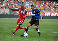 Chicago Fire defender Cory Gibbs (5) and Manchester United forward Federico Macheda (27) battle for the ball.  Manchester United defeated the Chicago Fire 3-1 at Soldier Field in Chicago, IL on July 23, 2011.