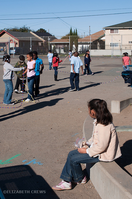 Oakland Ca 2nd grade Latina student feeling isolated from group at recess