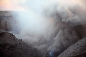 Ash rising from Bocca Nuova Crater after a small explosive eruption, Mount Etna Volcano, Sicily, Italy.