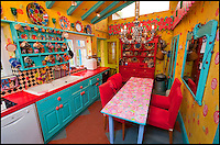 BNPS.co.uk (01202 558833)<br /> Pic: PhilYeomans/BNPS<br /> <br /> The garish kitchen.<br /> <br /> Britain's wackiest property has come on the market...And the estate agents mantra of paint everything magnolia has definately not been applied.<br /> <br /> It may look like an idyllic cottage in the Forest of Dean from the outside but ceramic artist Mary Rose Young's unique taste has transformed the interior into what looks like something from Alice in Wonderland.<br /> <br /> The three-bedroomed house is decorated from head to toe in crazy colours, clashing patterns, and enormous murals,<br /> each room is covered in the garish designs, including the bathroom, where even the sink and toilet have been adorned in bright tiles.<br /> <br /> Estate agents Bidmead Cook now have the tricky task of showing prospective punters round the &pound;500,000 property.