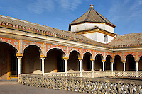 Low angle view of upper portico, Casa de Pilatos (Pilate's House), Seville, Spain, pictured on December 30, 2006, in the afternoon. Pilate's House, late 15th century, was built by the Enriquez and Ribera families During the 16th century these families, who had a strong relationship with Italy,  introduced the Renaissance style to Seville. The buildings were further modified according to Romantic taste in the 19th century and now present a combination of Mudejar-Gothic, Renaissance and Romantic styles. Today the Casa de Pilatos belongs to the Fundacion Casa Ducal de Medicaneli and is the residence of the Dukes of Medicaneli. Picture by Manuel Cohen.