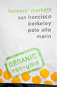 Close Up of Sign Promoting Berkeley Farmers' Market by Hodo Soy Beanery. The company makes soy based foods that are organic and non-GMO. Ecology Center's Berkeley Farmers' Market prides itself on being a 'Zero Waste Zone' and prohibiting genetically modified foods. Berkeley, California, USA