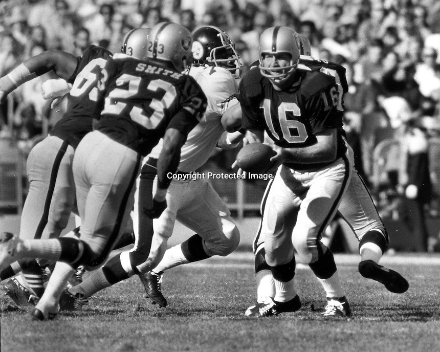 Oakland Raiders George Blanda hands off to Charlie Smith in game against the Pittsburg Steelers at the Oakland Alameda County Coliseum. (photo by Ron Riesterer)