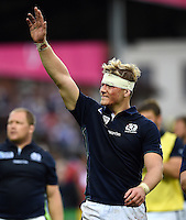 David Denton of Scotland waves to the crowd after the match. Rugby World Cup Pool B match between Scotland and Japan on September 23, 2015 at Kingsholm Stadium in Gloucester, England. Photo by: Patrick Khachfe / Onside Images