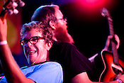 Phil Cook goes shoulder to shoulder with brother Brad Cook as Megafaun rocks Hometapes' Friend Island day party at the Pour House during the Hopscotch Music Festival in Raleigh, N.C., Friday, Sept. 10, 2010.