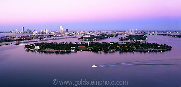 Miami Florida cityscape at dawn viewed from a rooftop in Miami Beach.  Star Island is in the foreground.