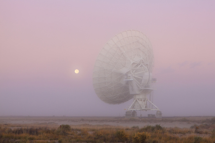 Fog, the full moon, and the Very Large Array (VLA). The Plains of San Augustin in southwestern New Mexico on