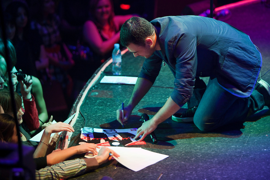 "Moscow, Russia, 07/03/2011..Azerbaijani rock singer Emin Agalarov signs autographs during a concert at the Rai nightclub. Agalarov has released 5 albums, and his first UK album ""Memory"" is due for release. He is also the commercial director of the Crocus International company, founded by his father Aras, and married to Leila Alieva, daugher of Azerbaijan President Ilkham Aliev."