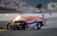 Sept. 16, 2012; Concord, NC, USA: NHRA pro stock driver Shane Gray on fire as he crashes during the O'Reilly Auto Parts Nationals at zMax Dragway. Gray would be uninjured. Mandatory Credit: Mark J. Rebilas-US PRESS