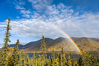 Double rainbow over Grayling lake and the autumn colored foliage in the foothills of the Brooks range mountains, arctic, Alaska.
