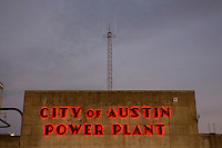 The City of Austin Seaholm Power Plant iconic art deco neon sign shines bright in downtown Austin, Texas.